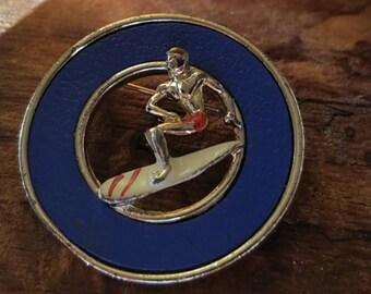 Vintage silver metal surfer brooch or pin