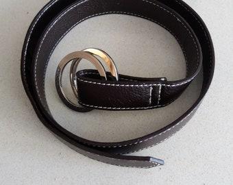 Brown belt with metal rings.