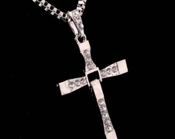 Back by popular demand, you've see the movie now own a piece of it. Toreto cross Necklace.