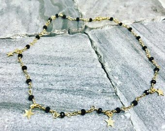 Gold black beaded necklace with stars.  Perfect gift for this holiday season.