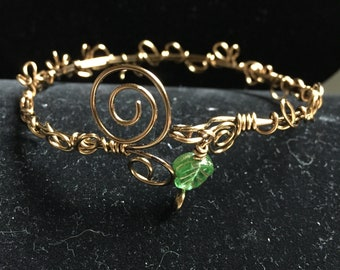 Bangle bracelet wire wrapped in antique copper with green stone