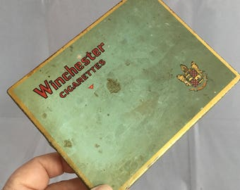 Almost antique Winchester Cigarettes tin. Vintage advertising. Collectable cigarette tin from the 1930's. Winchester Cigarettes.