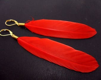 A pair of long red feather dangly leverback hook earrings.
