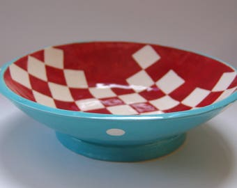 Whimsical pottery Serving Bowl turquoise w/ red & white hand-painted checker board print inside