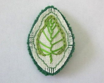 Green fabric pin, textile jewelry, fabric brooch, hand embroidery, textile jewellery, hand sewn, leaf brooch, green and cream, linen felt