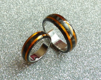 Carbon copper and stainless steel inner wedding rings