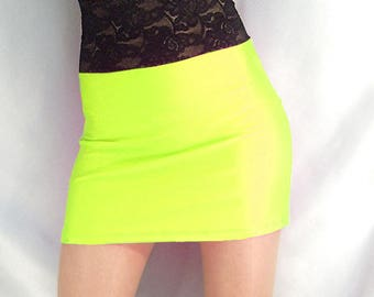 High waisted neon yellow shiny spandex mini skirt with black lace top