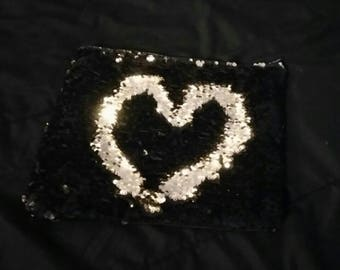 Reversible sequin pouch purse