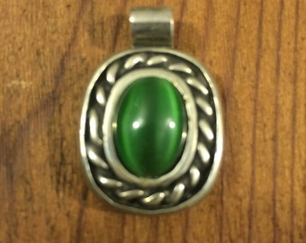 Vintage Silvertone Oval pendant with green stone