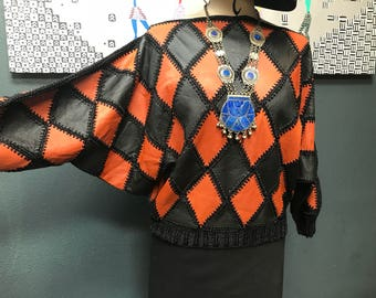 Ultra 70's/80's diamond patchwork leather vintage sweater.