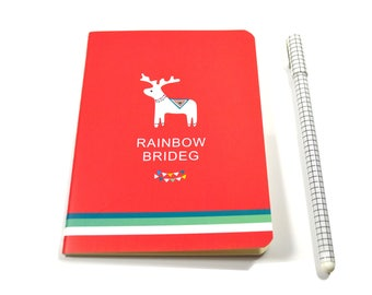 Small notebook red and small white reindeer