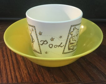 A Texas Ware/MelamineYellow Bowl, and a Selandia/Melamine Pooh Cup!
