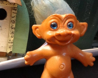 Vintage troll, made in Korea, with multi colored blue hair and bright blue eyes
