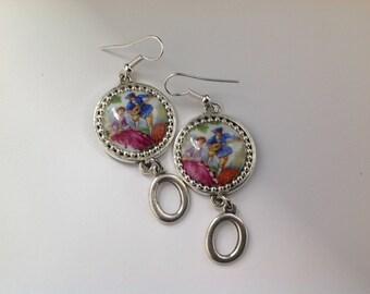 silver color, a dangle earrings
