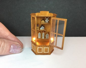 Miniature micro 1:48 or 1/24th scale cabinet with lights and tiny dollshouses inside