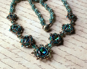 Hand Beaded Necklace with Swarovski Crystals, Rivolis and Chatons wtih Antique Brass button toggle