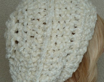 Slouchy white winter hat in women's fashions, soft and cozy, original handcrafted crochet, versatile styles and has a whimsical bauble