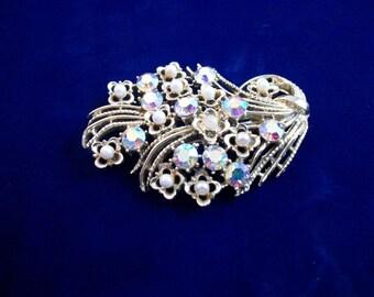 Stunning Coro Pegasus gold tone, faux pearl and clear AB rhinestone brooch.
