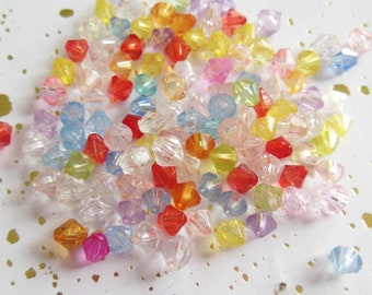 set of 100 beads shaped plastic tops