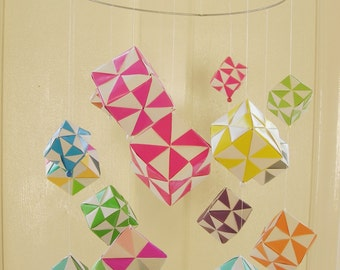 Paper Mobile of cubes in bright colors. Nursery.
