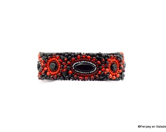 Small embroidered red and black cuff
