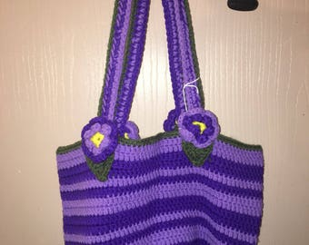 Purple striped purse with flowers