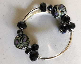 Black lampwork and faceted bed memory wire bracelet