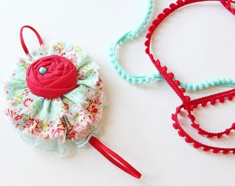 Floral Frolic headband - red and aqua floral ruffle and rosette bow