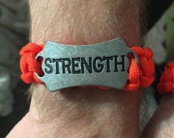 Orange paracord bracelet with strength charm