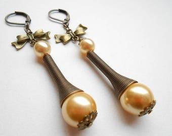 Earrings bronze Cone and Pearl shining beige glass.
