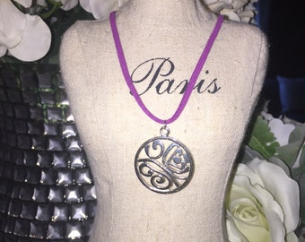 Suede necklace with swirl silver disc
