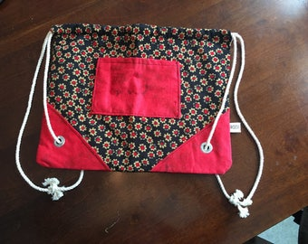 Black and Red Flowers Adventure Bag