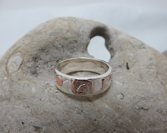 Sterling silver patterned brass ring