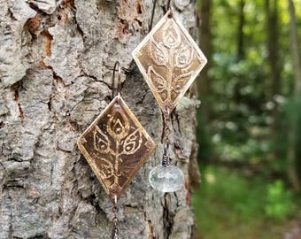 Handmade etched bronze earrings.