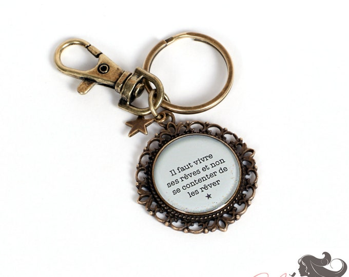 Jewelry bag / key ring T48 quote the feather to the ear in resin and brass support