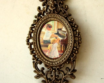 Victorian Small Oval Frame Wall Hanging with Childrens Image at Piano Lesson Time