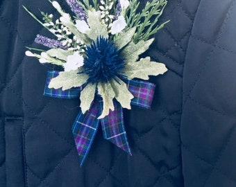 Thistle & white Heather buttonhole with Pride of Scotland tartan ribbon