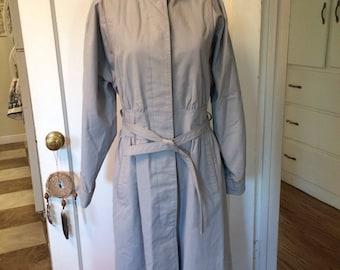 Vintage 1980's women's rain jacket/coat trench coat style. Size small
