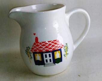 White 16 Oz. Creamer With A Home Motif On The Front/Made In China/Great Used Condition/(S)