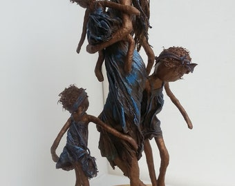 Peekaboo! Mixed media sculpture of mother and children. Available