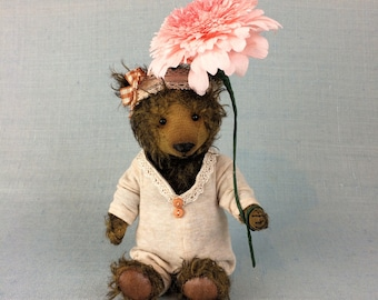 Cute little artist teddy bear made of brown mohair with leather paws.