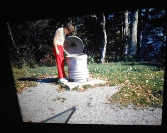 Vintage Abstract 35mm Slide Women Perplexed By a Garbage Can 1970