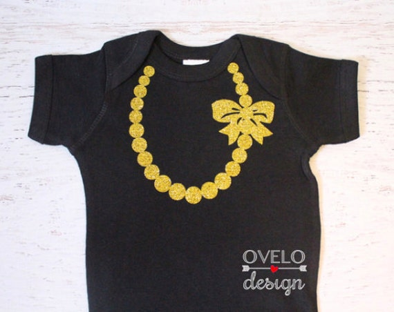 The Carrie Pearl Gold Glitter Necklace with Bow on Black Bodysuit with Gold Glitter Pearls and Bow Breakfast at Tiffany's