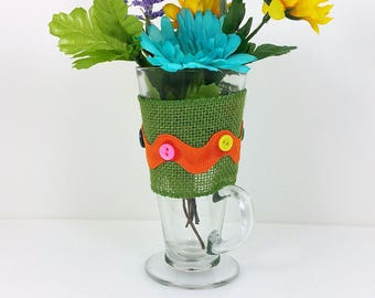 Burlap glass mug yellow and blue flowers with green and orange leaf trim 114