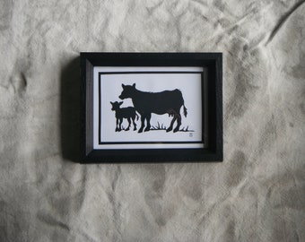 Framed Papercut Cow with Calf. In Black and White