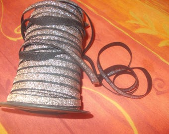 0.75 cm black and silver elastic for straps 1 cm wide