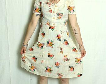 Vintage dress with beige flowers