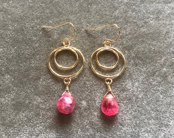 Golden hoops with pink topaz drops