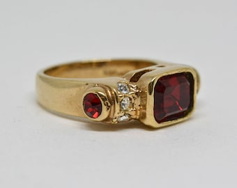 charming gold tone and red stone ring