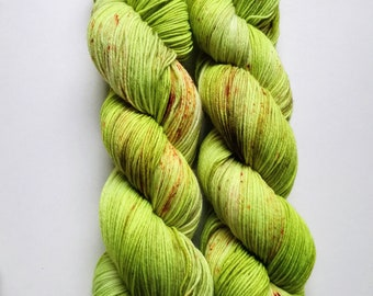 Passion Flower: hand dyed tonal and speckled Merino sock yarn by Star Fiber Studio